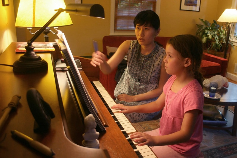 tutor teaching piano