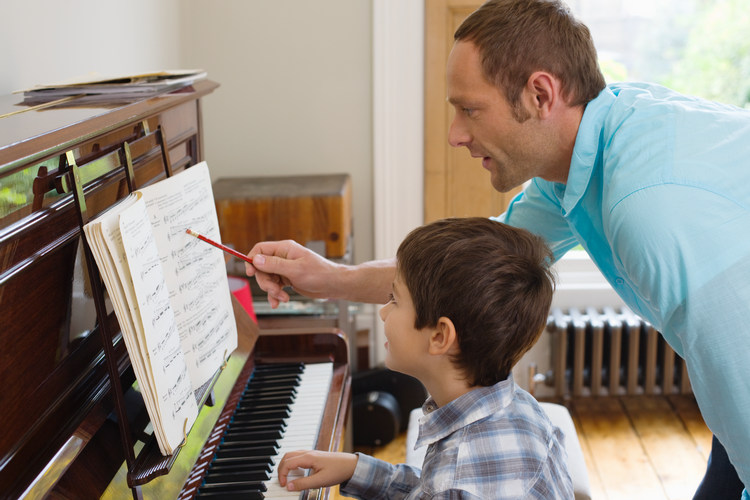 piano tutor with student