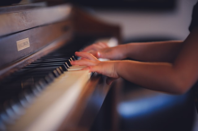 young girl playing piano
