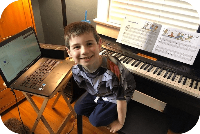 boy with keyboard and laptop