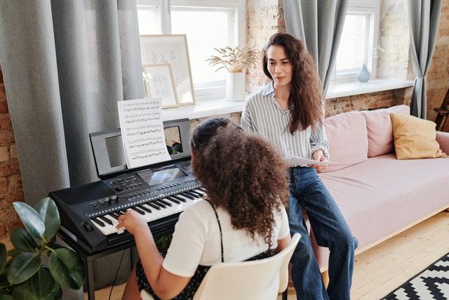 piano tutor explaining to student