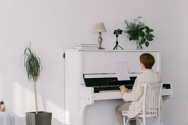 boy playing piano on video call