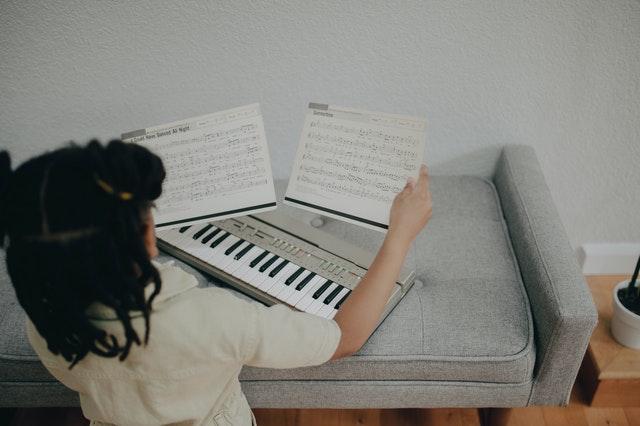 girl reading sheet music